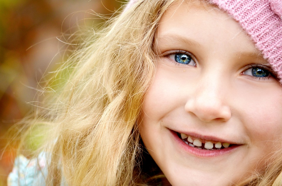 Smiling Little Girl with Hat